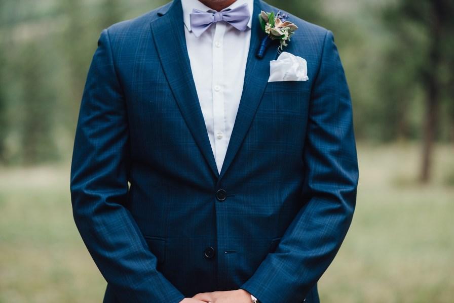 groom in blue suit, Calvin Klein