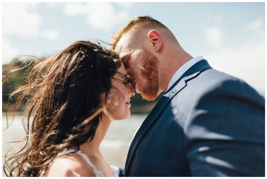 Windy wedding photos. Eskimo kisses
