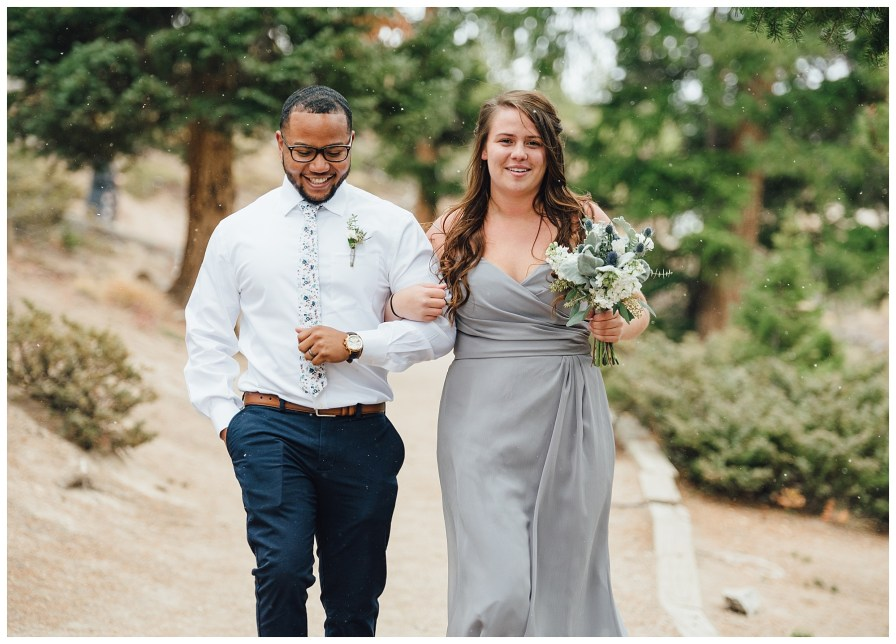Best man and maid of honor walk down the aisle together.