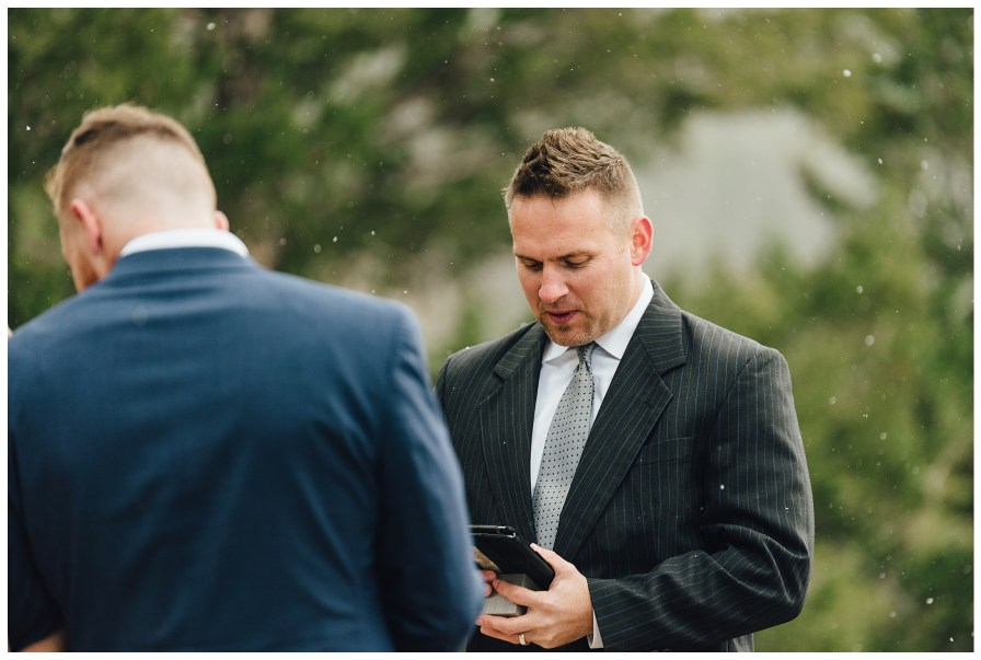 Officiant prays over the couple