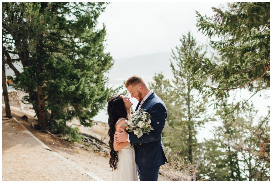 Embracing each other away from the rest of the wedding