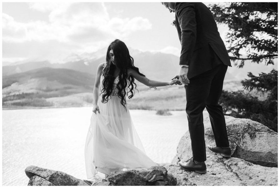 Bride and groom at Sapphire Point overlooking Dillon Reservoir