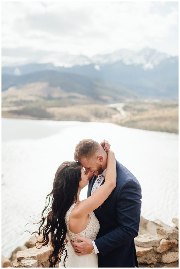 Bride and groom embrace each other atop Sapphire Point