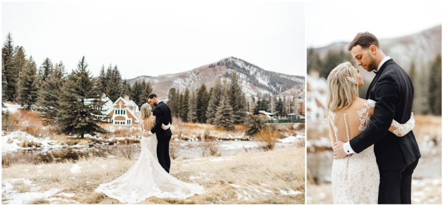 Bride and groom share a sweet moment at the base of a mountain in Vail at their snowy winter elopement