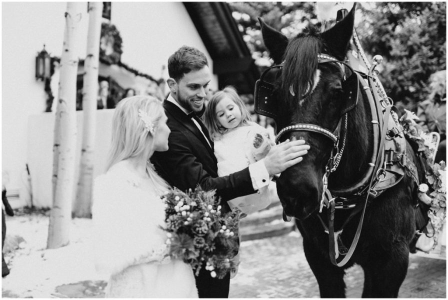 Carriage ride after their wedding in Vail Colorado