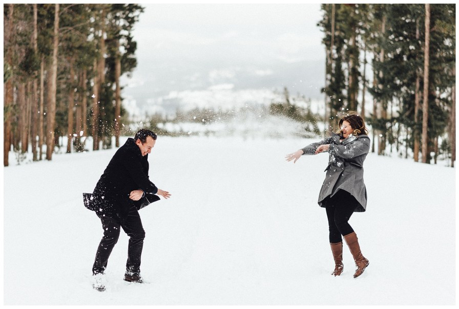 Snowball fight during engagement photos
