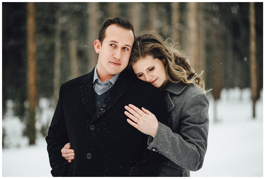 Engagement photos amidst the evergreens in Winter Park Colorado