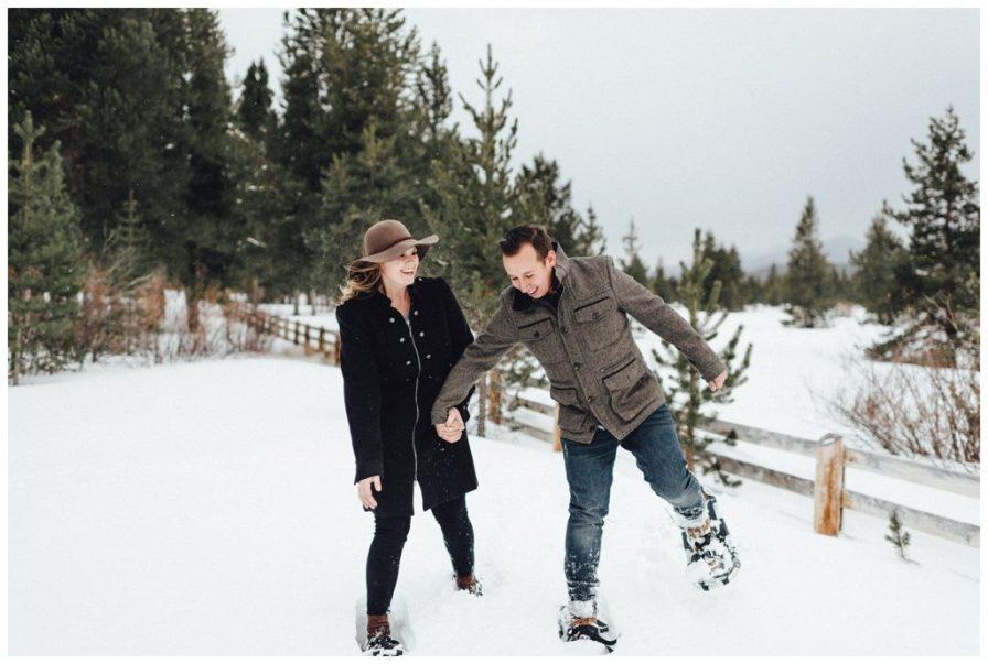 Snoeshoeing engagement photos in Winter Park Colorado