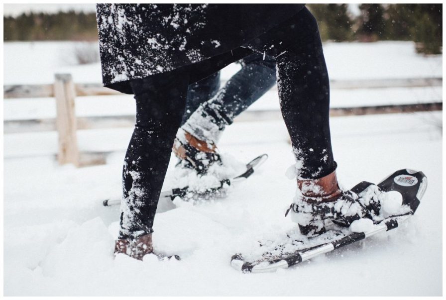 Adventurous couple goes for a snowshoeing engagement on a snowy day in Colorado