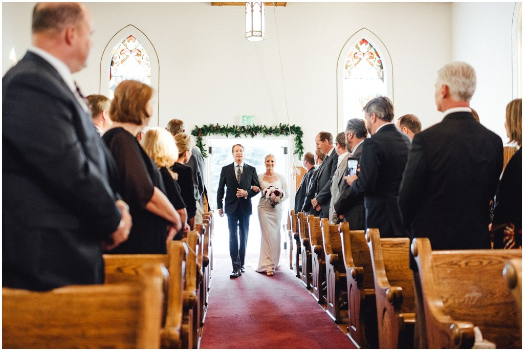 Brides father walking her down the aisle