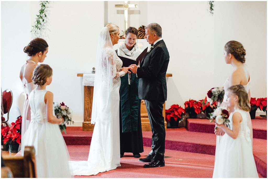 Couple exchanging rings at their wedding