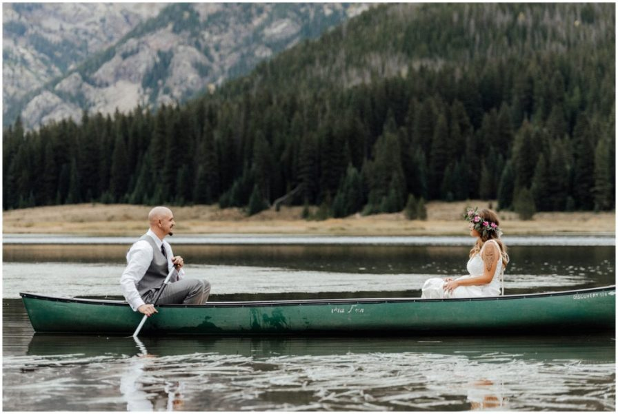 grooms rows his bride around lake