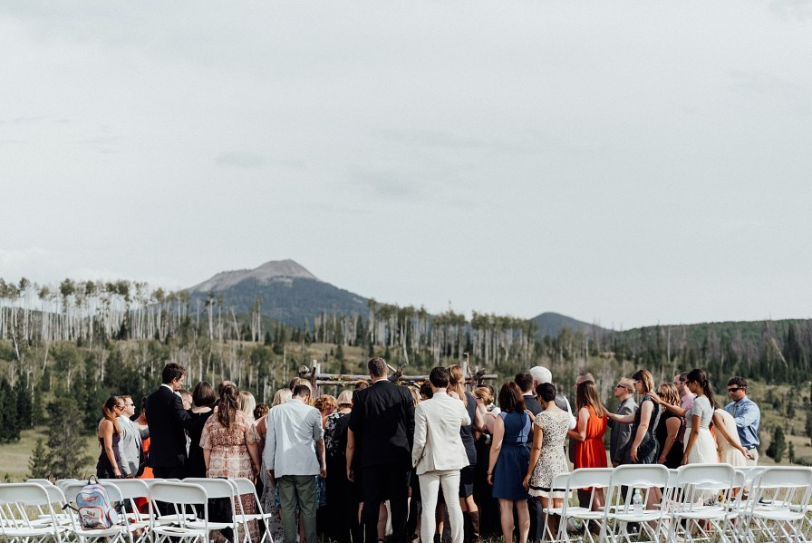 Guests pray over the couple during the ceremony