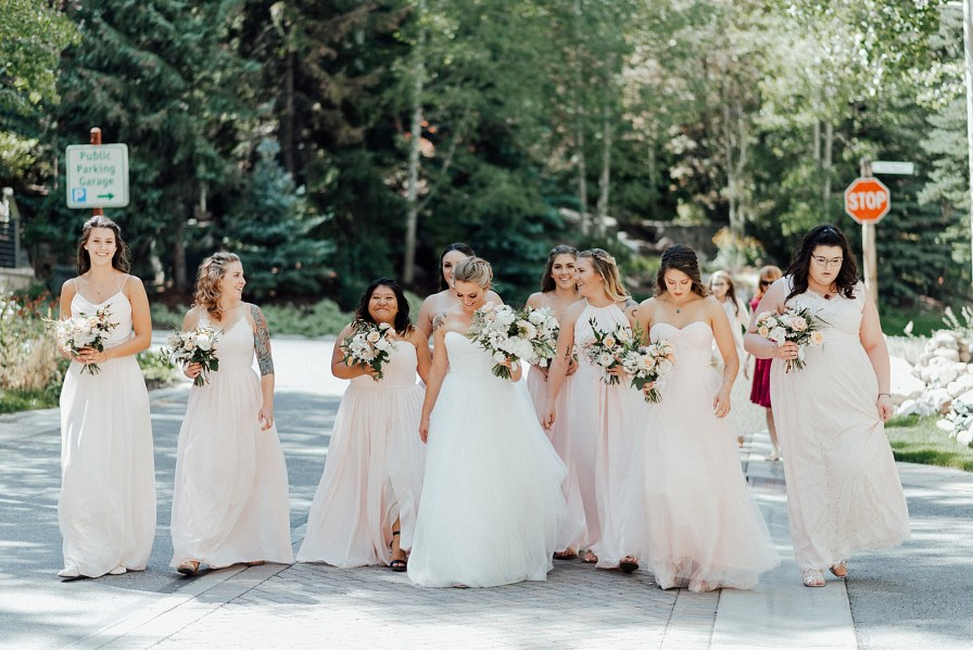 Bride and bridesmaids walking through Vail