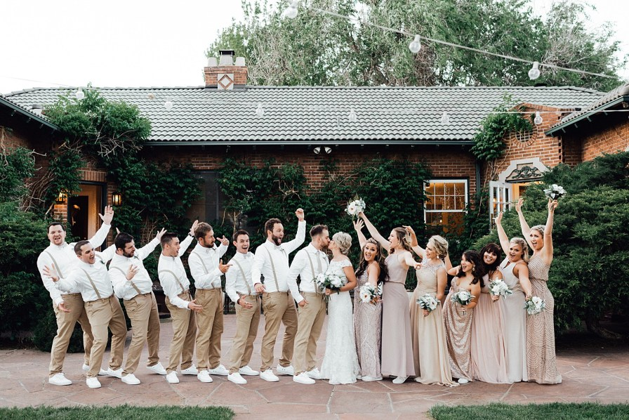 Wedding party photos, wedding party photo ideas, khaki wedding attire, groomsmen suspenders, champagne bridesmaid dresses, blush bridesmaid dresses, gold bridesmaid dresses