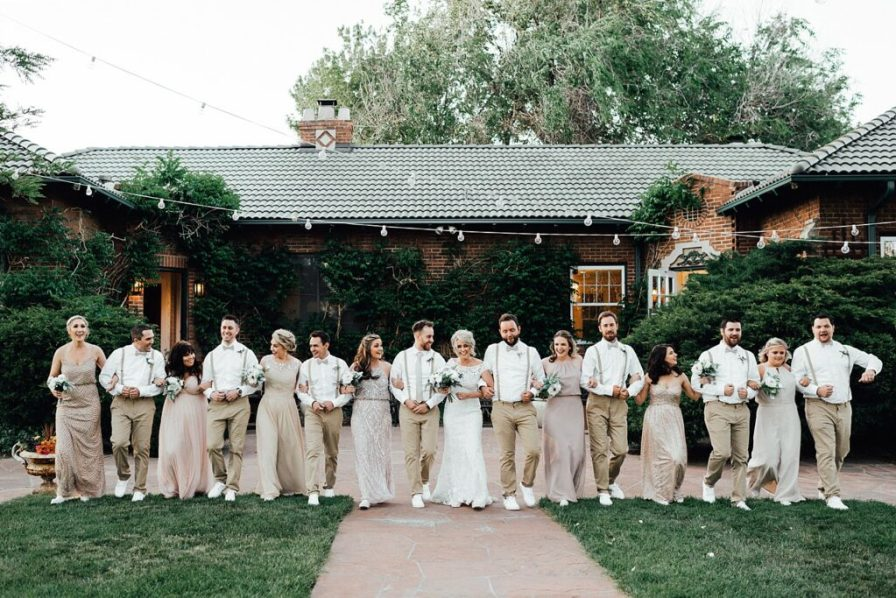 Wedding party photos, wedding party photo ideas, khaki wedding attire, groomsmen suspenders, champagne bridesmaid dresses, blush bridesmaid dresses, gold bridesmaid dresses, bridesmaid and groomsmen photo ideas, bridal party photo ideas