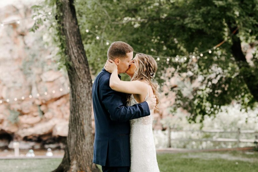 bride and groom kiss at their River Bend summer wedding