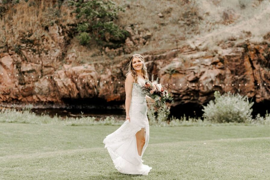 bride enjoys her River Bend summer wedding