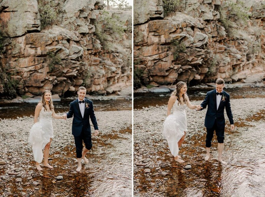 bride and groom take off shoes and get in water on wedding day