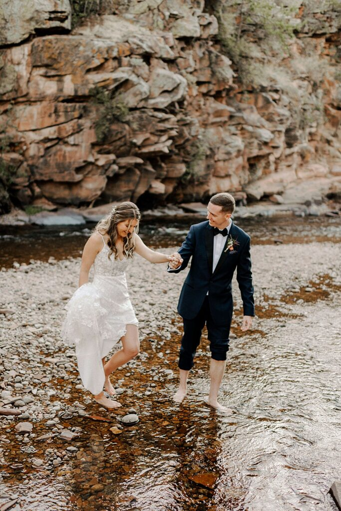 barefoot in the stream at River Bend summer wedding