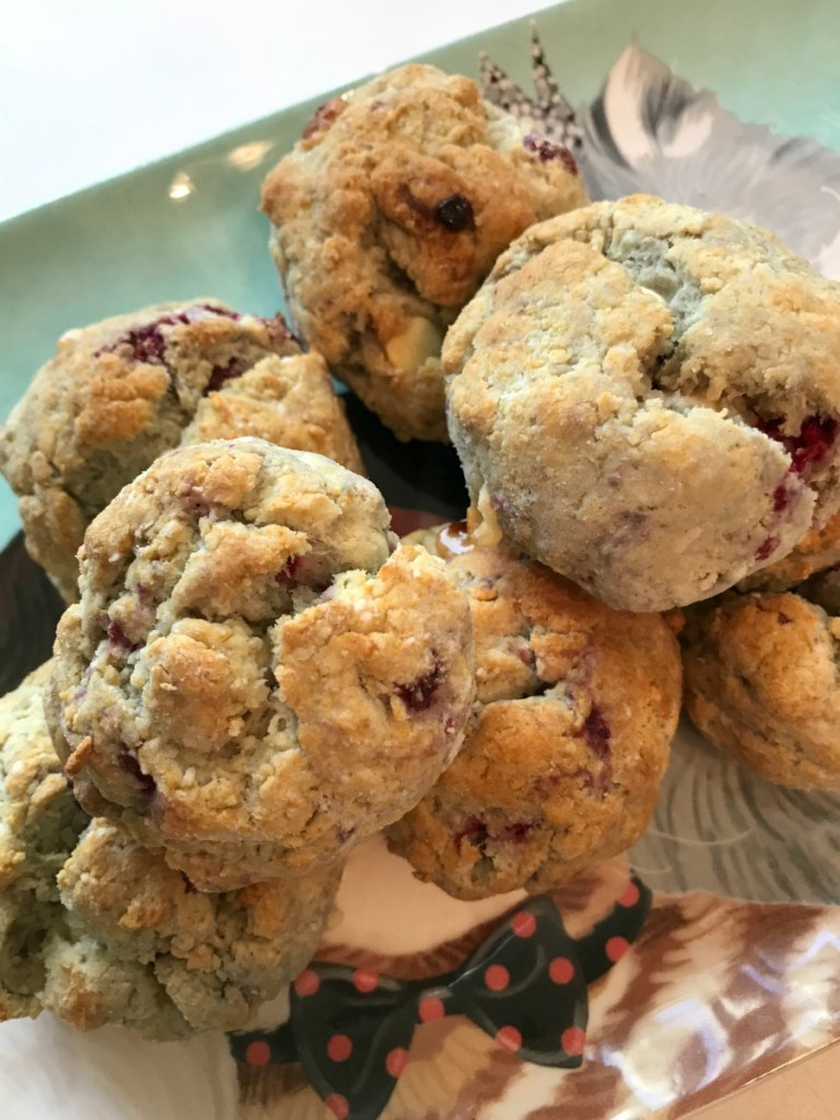 Plate of gluten free raspberry and white chocolate scones | Erika's Gluten-free Kitchen www.erikasglutenfreekitchen.com