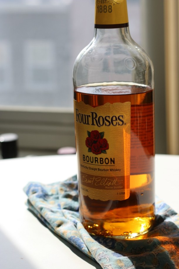 Bottle of Four Roses Bourbon in the sunlight on a kitchen table.