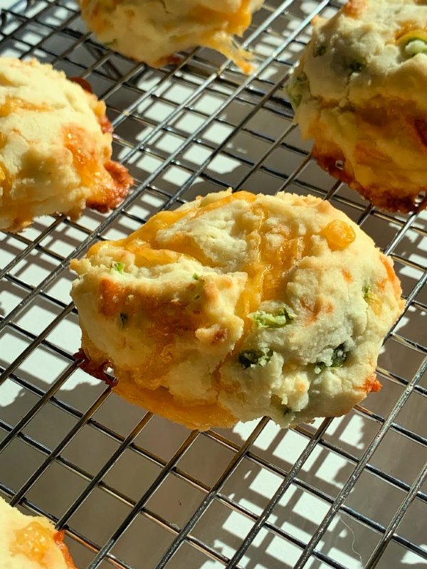 Gluten-free Jalapeno Cheddar Cheese Scone on a wire rack.