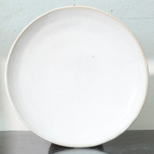 Erik Haugsby Pottery set of two white ceramic plates with handmade nuka glaze
