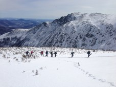 A group coming up Lions Head with Boot Spur in the background
