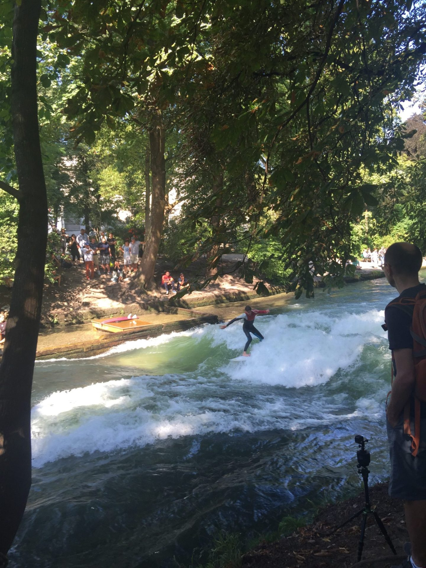 Surfers on Eisbach canal, Munich