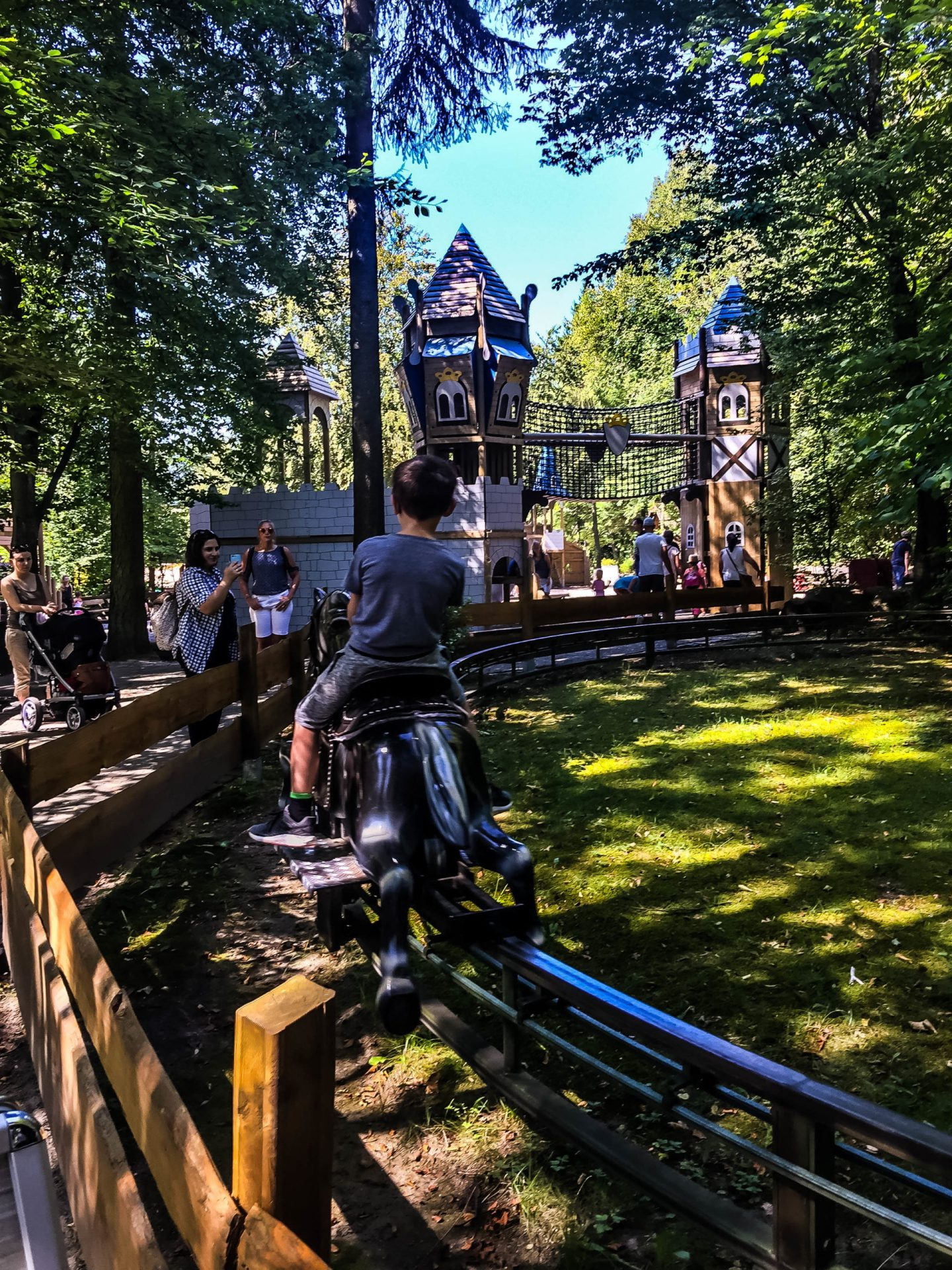 The little mechanical horse ride in the trees at Märchen-Paradies.