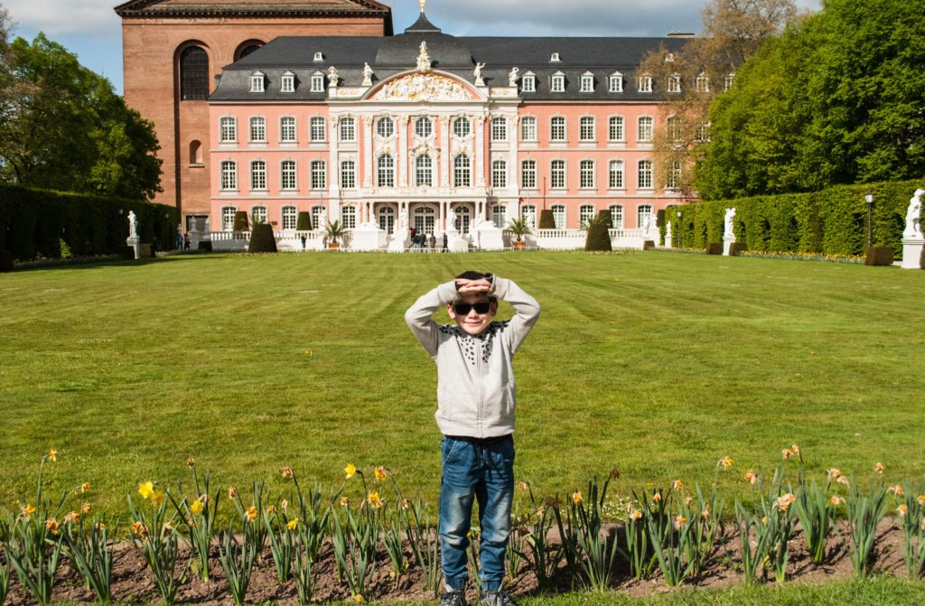 My son in front of the Elector Palace in Trier.