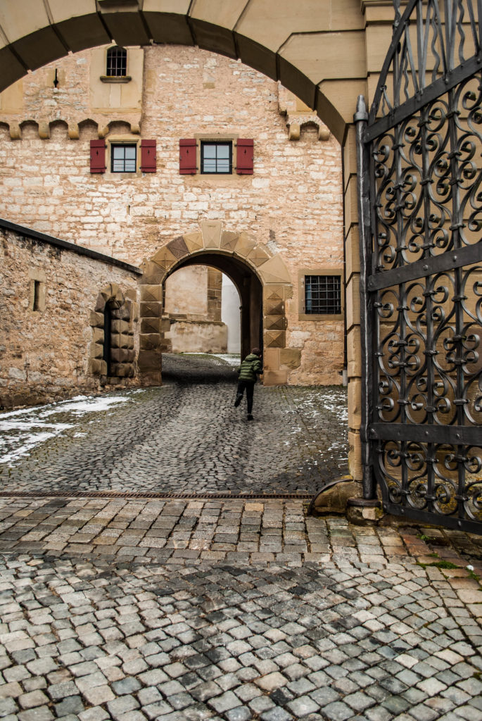 My son running into the monastery gates