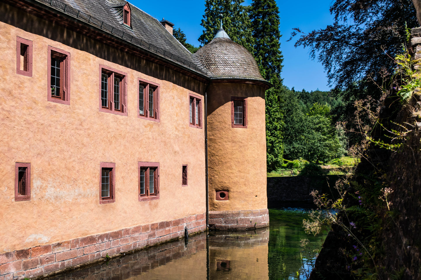 The lake runs on all sides of the Castle Mespelbrunn, like a very large moat.
