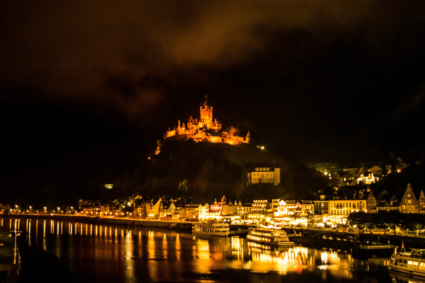 The Cochem Castle lit up at night