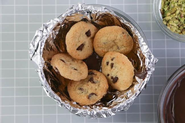 Adding the last cookie petal. | Erin Gardner | Erin Bakes