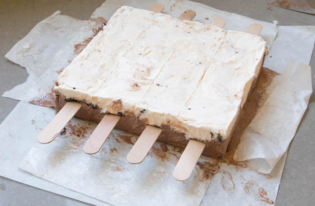 Adding Popsicle Sticks to the Ice Cream Cake Pops | Erin Bakes