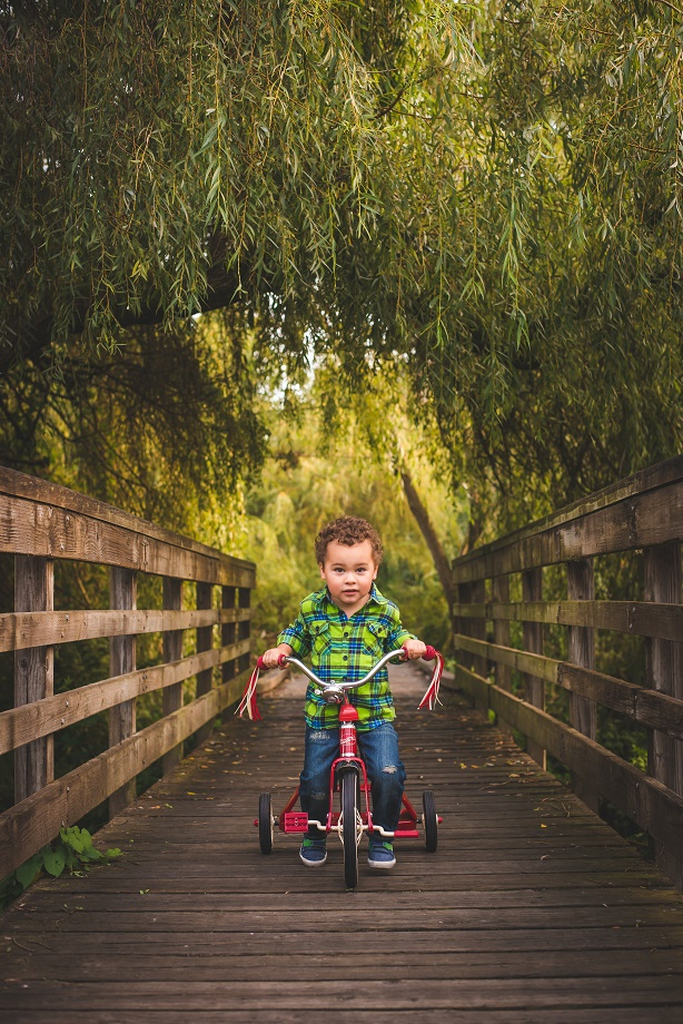 kirkland wa family photographer photo of boy on trike