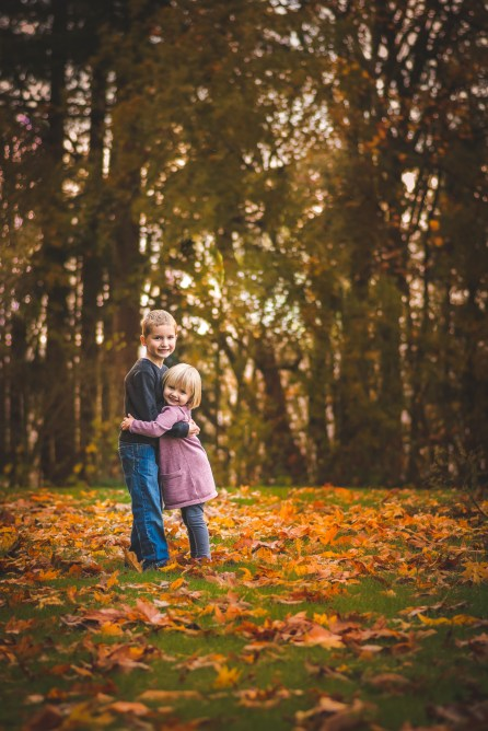 Seattle family photographer captures beautiful golden Autumn leaves and young children