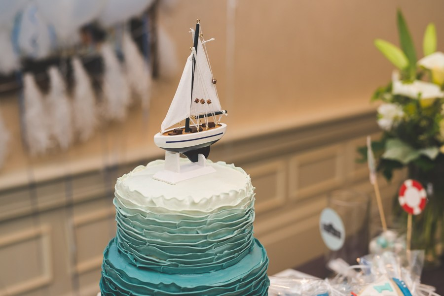 sailboat themed blue and white birthday cake