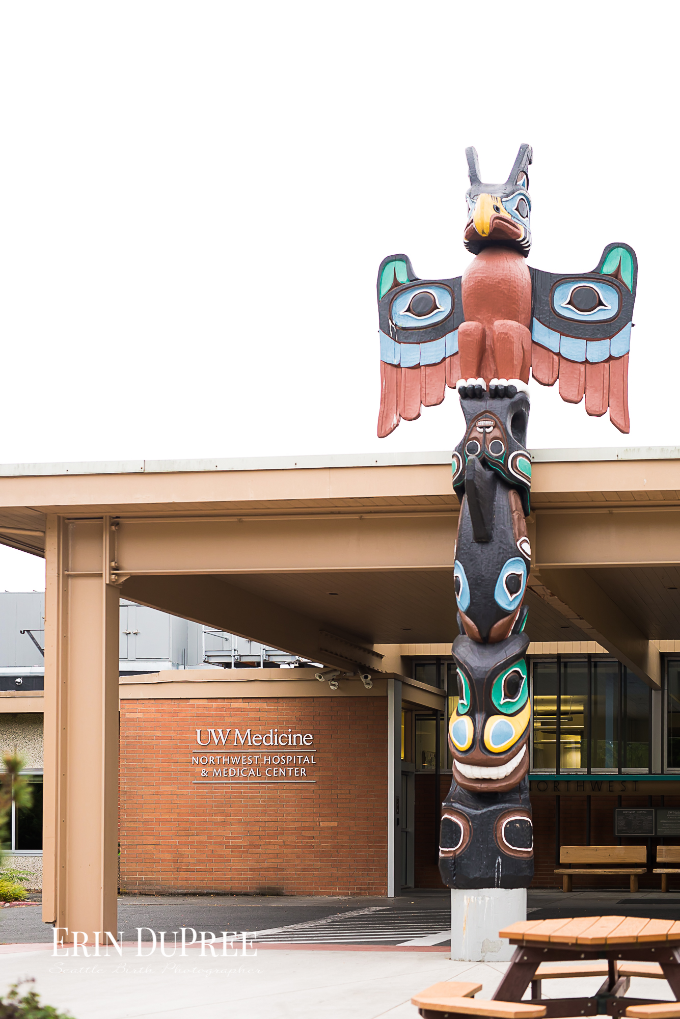 Hospital entrance and native american totem in Seattle wa by Seattle Birth Photographer