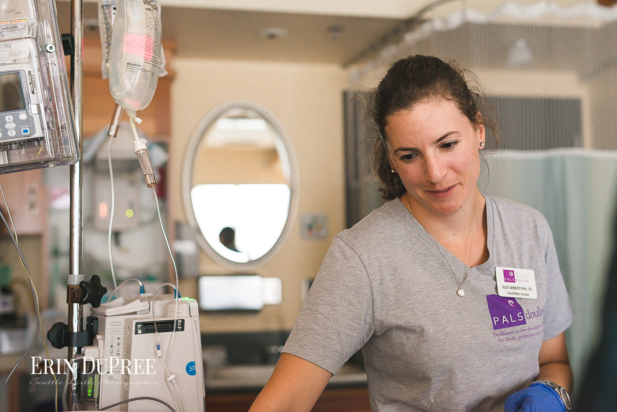 PALS Doula looking down at woman in labor by Seattle Birth Photographer