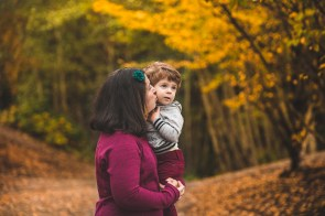 Photo of a mom kissing her young son Seattle family photographer Bellevue WA