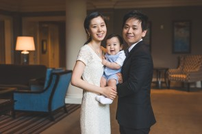 Family of three in the Woodmark hotel in Kirkland by the best Seattle family photographer