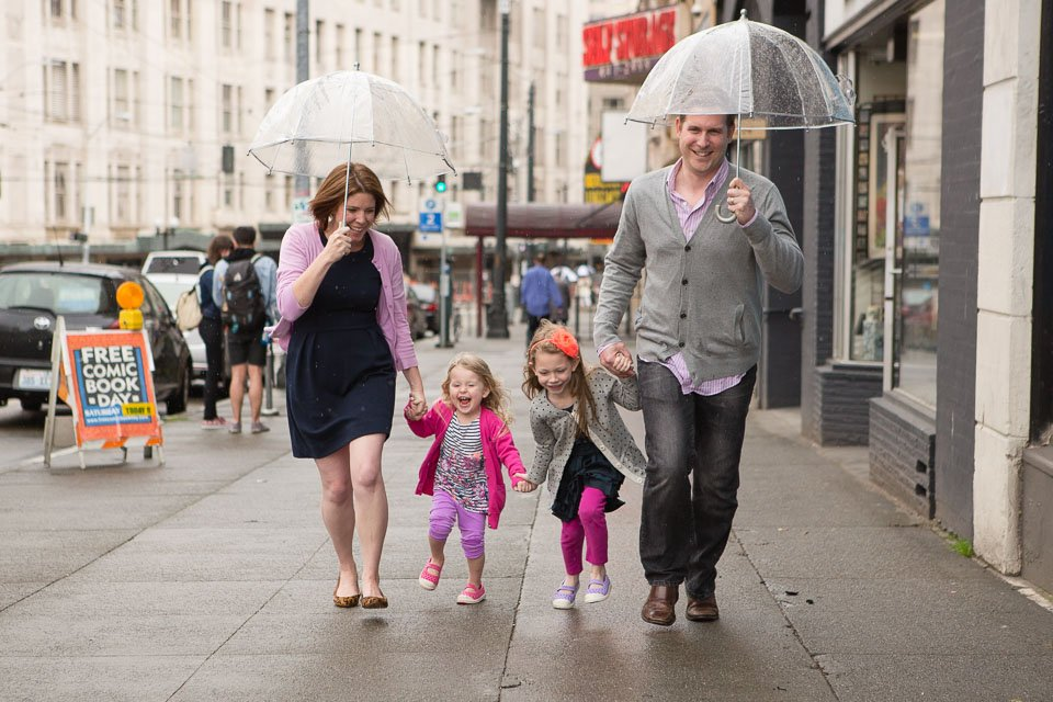 Family of 4 in running in the rain in Seattle