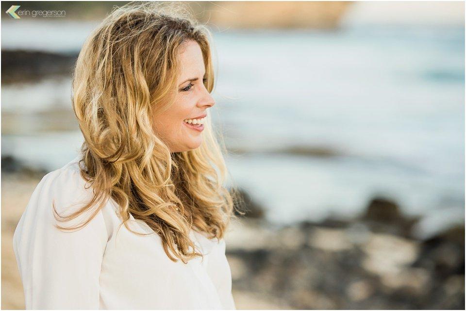 Beautiful woman with windblown hair Kauai beach