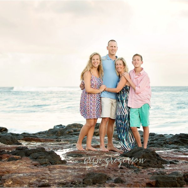 family photo session shipwrecks beach kauai lava rocks family of four