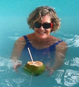 In pool with coconut drink