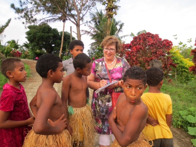 Therese sketching with the village boys