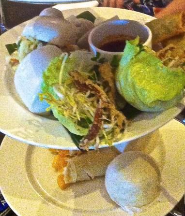 Barramundi spring rolls, crispy pigs ear & noodle salad, braised pork belly bun, gow gee vegetarian & prawn dumpling